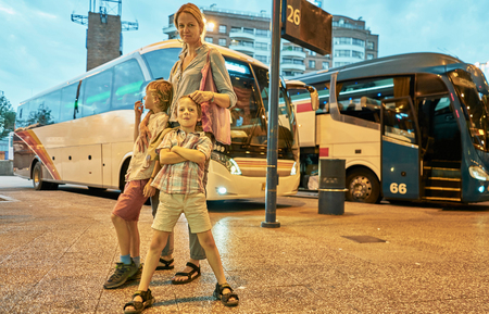 Mother and sons at bus station, Montevideo, Uruguay, South America