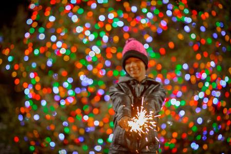 Teenage boy holding sparklers