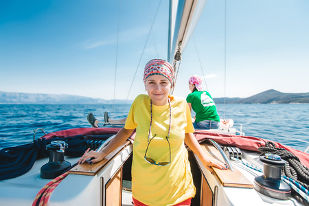 Portrait of young woman yachting, Croatia LANG_EVOIMAGES