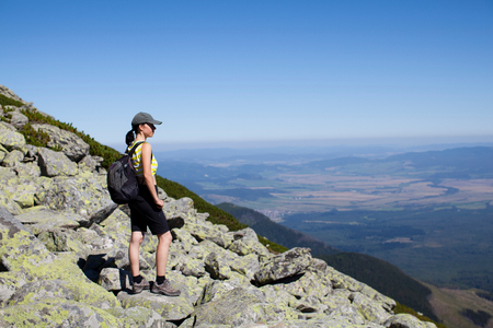 Hiker enjoying view at top, Star� Smokovec, Presov, Slovak Republic LANG_EVOIMAGES