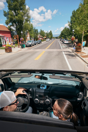 Road trip couple driving through town, Breckenridge, Colorado, USA