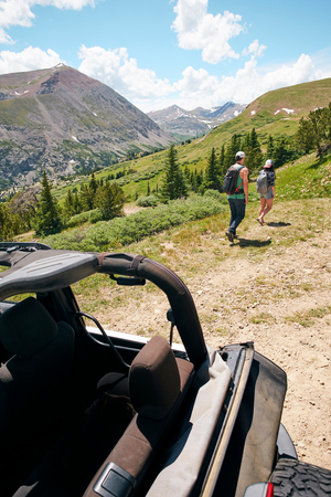 Road trip couple hiking in Rocky Mountains, Breckenridge, Colorado, USA LANG_EVOIMAGES