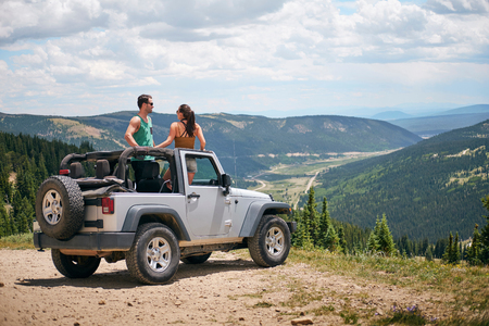 Road trip couple in four wheel convertible in Rocky mountains, Breckenridge, Colorado, USA LANG_EVOIMAGES