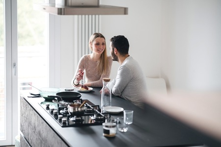 Couple in kitchen at breakfast bar