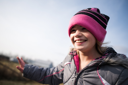 Happy young girl with beanie hat LANG_EVOIMAGES