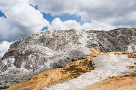 White mineral terraces on mountainside, Yellowstone National Park, Wyoming, USA