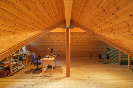 Desk and chair on pine panelled mezzanine in Scots pine piece sur piece log home