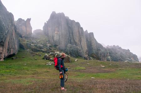 Rock climber at Hatun Machay, Huaraz, Ancash, Peru