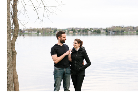 Couple relaxing by lake, Kingston, Canada LANG_EVOIMAGES