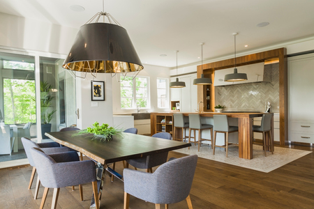 Dining room and kitchen area inside a luxurious contemporary home LANG_EVOIMAGES
