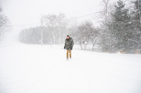 Man walking in blizzard, Bath, Canada