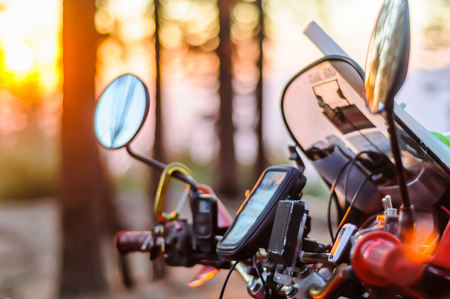 Windshield and controls of touring motorcycle at sunset, close up, Yosemite National Park, California, USA