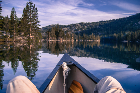 Man canoeing on Echo Lake, personal perspective, High Sierras, California, USA
