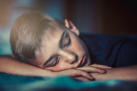 Boy sleeping on front LANG_EVOIMAGES