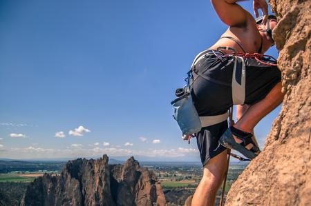 Rock climber rock climbing, Smith Rock State Park, Terrebonne, Oregon, United States LANG_EVOIMAGES