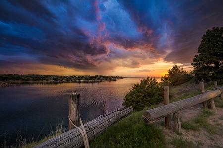 Fading supercell over lake at sunset, Ogallala, Nebraska, US