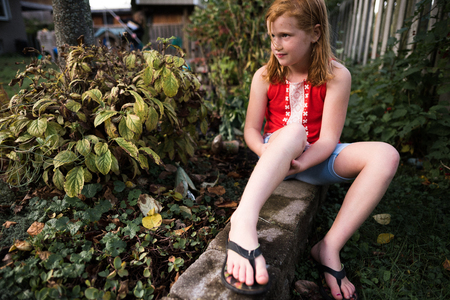 Girl relaxing in garden LANG_EVOIMAGES