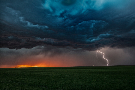 Asperatus clouds in sunset and cloud-to-ground lightning bolt, Ogallala, Nebraska, US