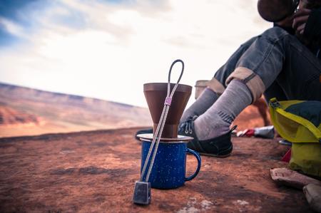 Rock climber making coffee,Desert Towers,Indian Creek,Moab,Utah,USA