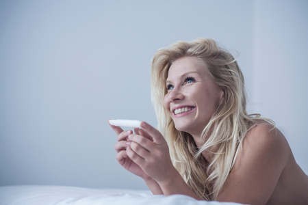 Happy woman with pregnancy test LANG_EVOIMAGES