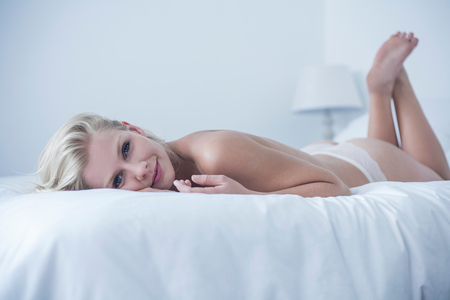 Woman on waking up in bed at home
