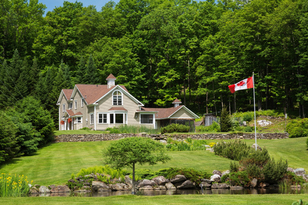 1990s Contemporary Victorian style country home with garden pond and Canadian flag