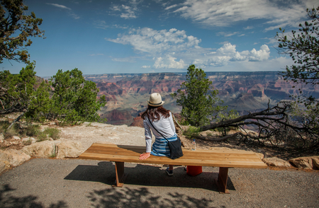 Tourist looking out at scenery,Grand Canyon,Arizona,USA LANG_EVOIMAGES