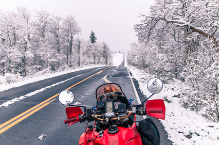 Touring motorcycle parked on roadside in winter,Placerville,California,USA LANG_EVOIMAGES