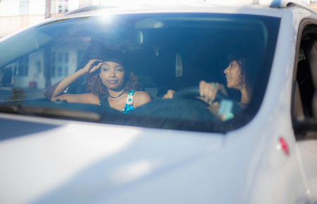Friends driving in car LANG_EVOIMAGES