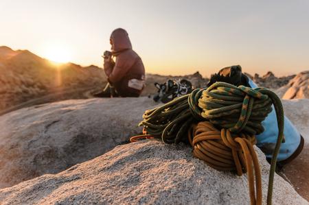 Rock climber on summit at sunset,Joshua Tree,California,USA