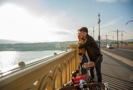 Couple on bridge with bicycles, Budapest, Hungary