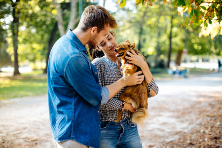 Couple with pet dog in park
