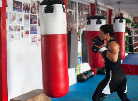 Female boxer training in gym