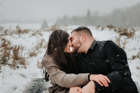Couple kissing in snow, Georgetown, Canada