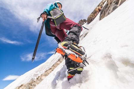 Rock climber in snowy slope, El Chalt�n, south Patagonia, Argentina