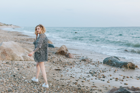 Young woman strolling on beach, portrait, Menemsha, Marthas Vineyard, Massachusetts, USA