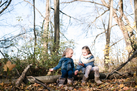 Sisters exploring nature in forest