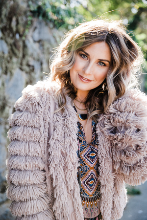Fashionable woman in fringe coat