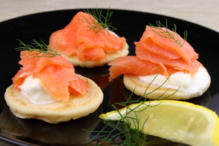 Blinis pancakes served with Creme Fraiche, Smoked Salmon and garnished with Dill