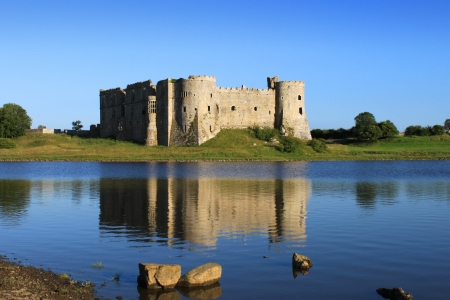 norman castle: Carew Castle and millpond in the Pembrokeshire National Park, Wales