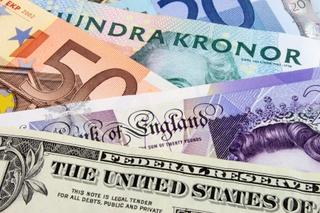 us currency: A close-up photograph of  Swedish, United States and Euro currency
