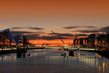 sunrise on the river liffey in dublin city ireland stock photo