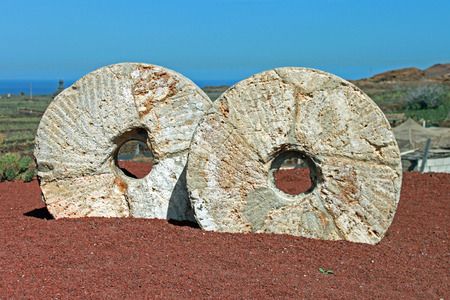 millstone: Two old millstones set into a volcanic landscape in the Canary Islands  Stock Photo