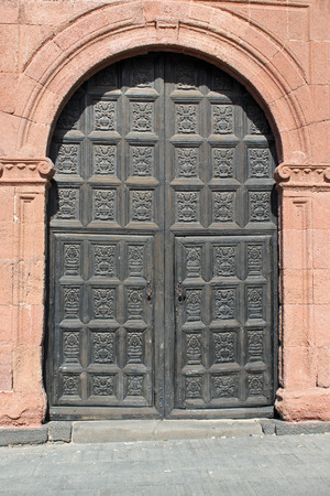 ornately: An old and ornately carved wooden church door Stock Photo