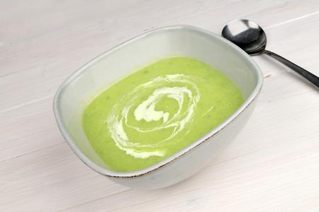 leek: A bowl of Leek & Potato Soup on a white wooden table.