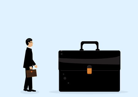 A businessman looking at a giant briefcase, a metaphor on big business.