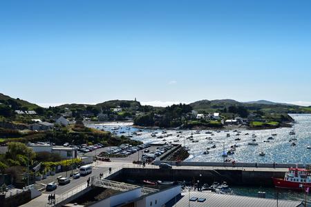 A view of Baltimore harbor and Baltimore beacon on the headland. Baltimore, West Cork, Ireland. 版權商用圖片