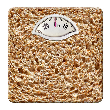 self indulgence: Weight scale with bread texture on white background