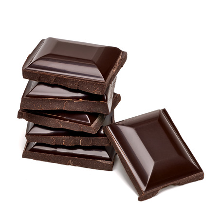 Chocolate tablets stack on white background photo