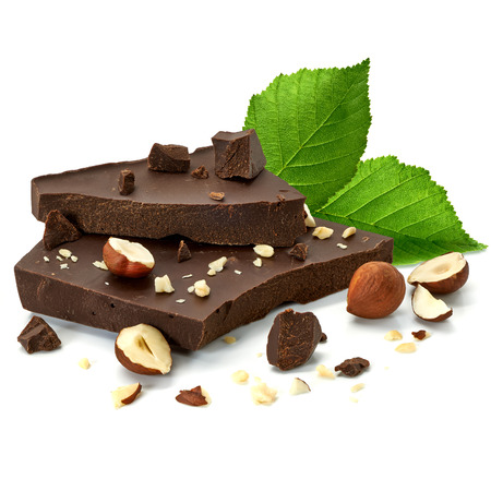 Broken chocolate blocks with hazelnuts on white background Stock Photo